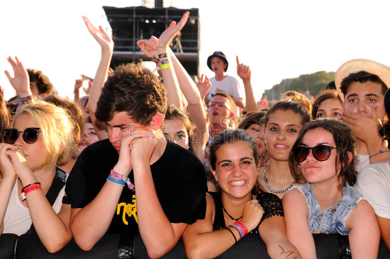 People from the crowd (fans) watch a concert at FIB Festival royalty free stock images