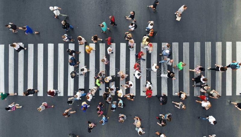 People crowd moving through the pedestrian crosswalk. royalty free stock photo