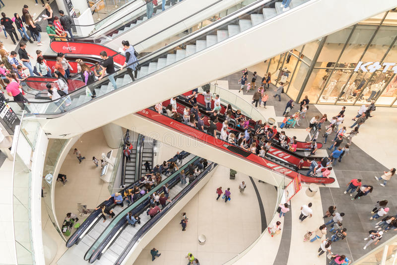 People Crowd Rush In Shopping Luxury Mall Interior Stairs stock photo