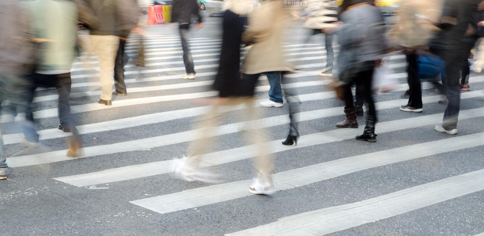 People crowd on zebra crossing stock photo
