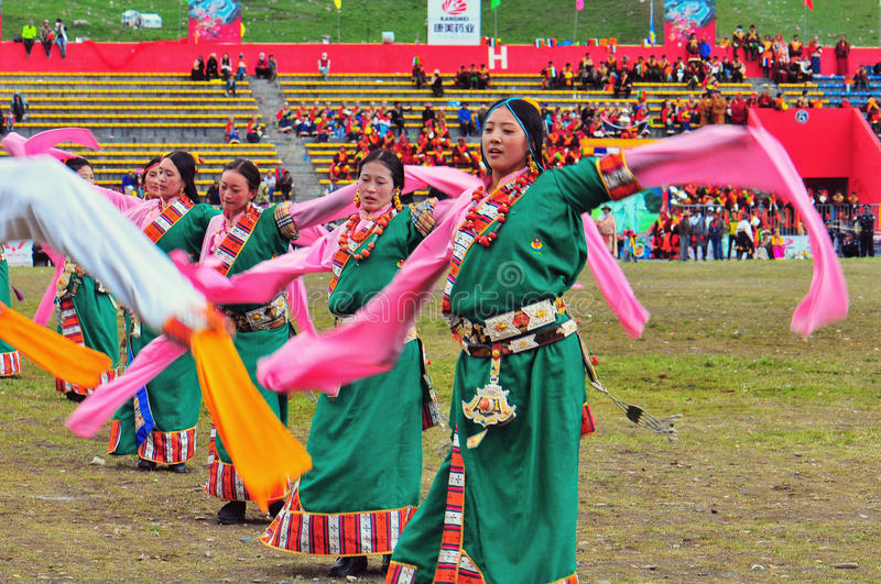 People dance tibetan dance. People sing and dance to celebrate the Kangba Art , Yushu, china royalty free stock photo