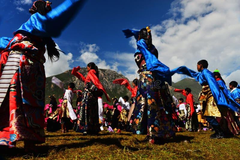 People dance tibetan dance. People sing and dance to celebrate the Kangba Art , Yushu, china royalty free stock image