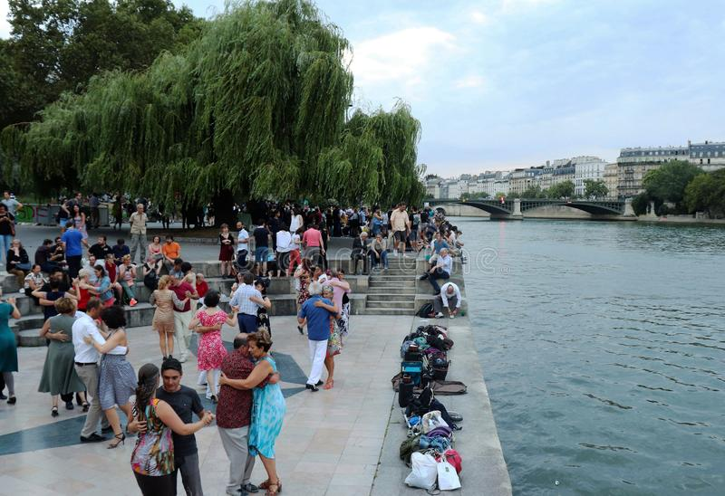 People dancing next to the river royalty free stock images