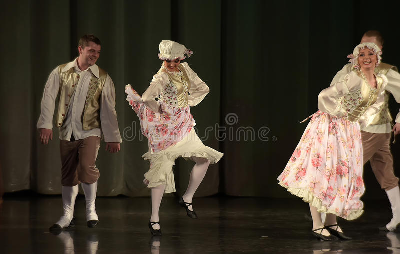 People dancing in traditional costumes on stage,. Performances dance group, St. Petersburg, Russia royalty free stock photos