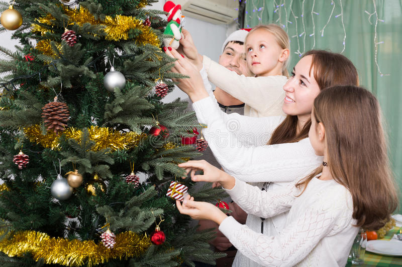 download people decorating christmas tree stock photo image 67111169 - People Decorating A Christmas Tree
