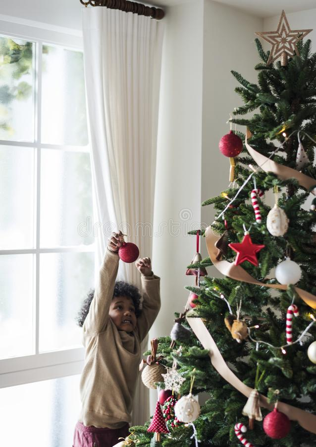 People decorating Christmas tree stock images