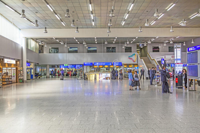 People in the departure hall at the Frankfurt International Airport stock images