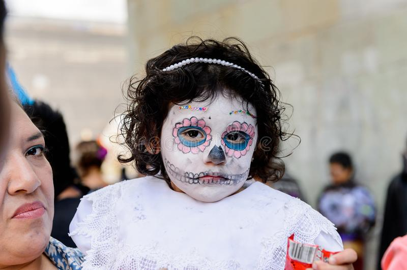 People on the Dia de los Muertos in Mexico. OAXACA, MEXICO - OCT 31, 2016: Unidentified girl painted as zombie for the Day of the Dead (Dia de los Muertos) royalty free stock images
