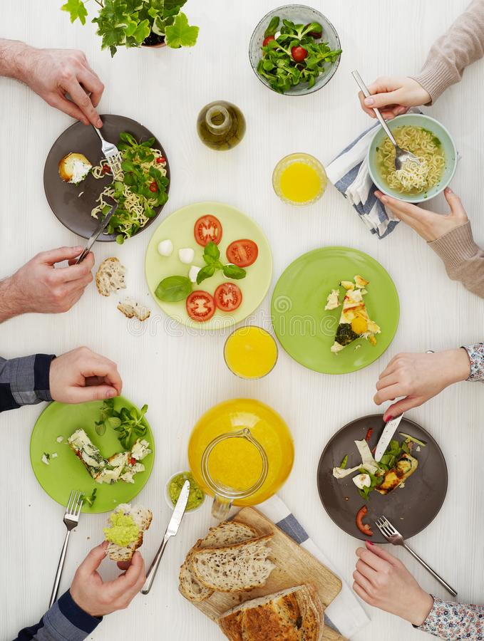 People at dinner table stock images