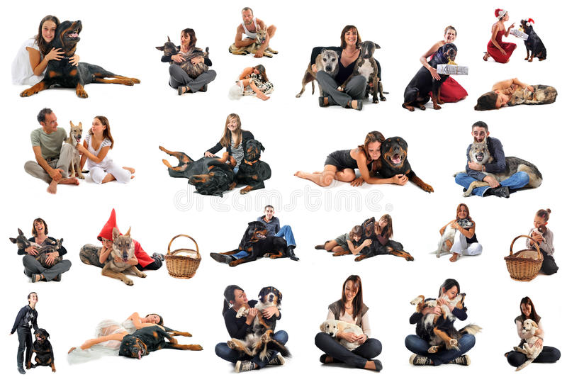 People with dogs. People with purebred dogs and puppies in front of white background stock photography