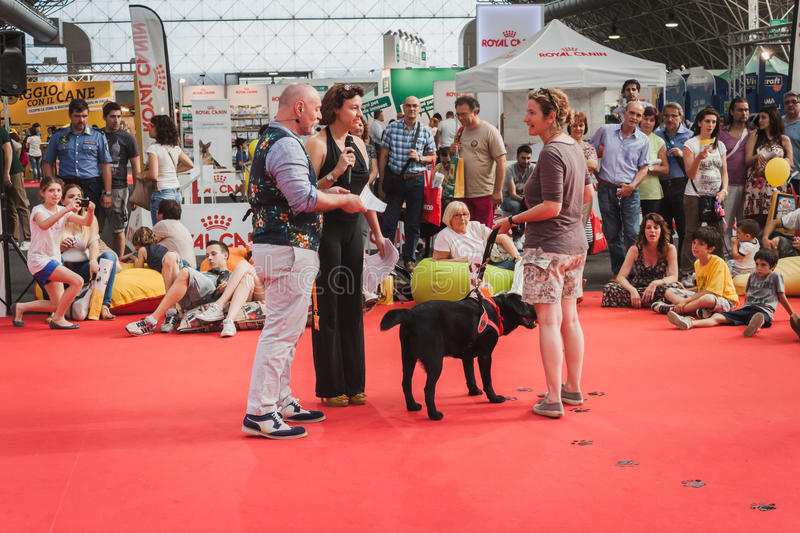 People and dogs at Quattrozampeinfiera in Milan, Italy. MILAN, ITALY - JUNE 7: People and dogs at Quattrozampeinfiera, event and activities dedicated to dogs royalty free stock images