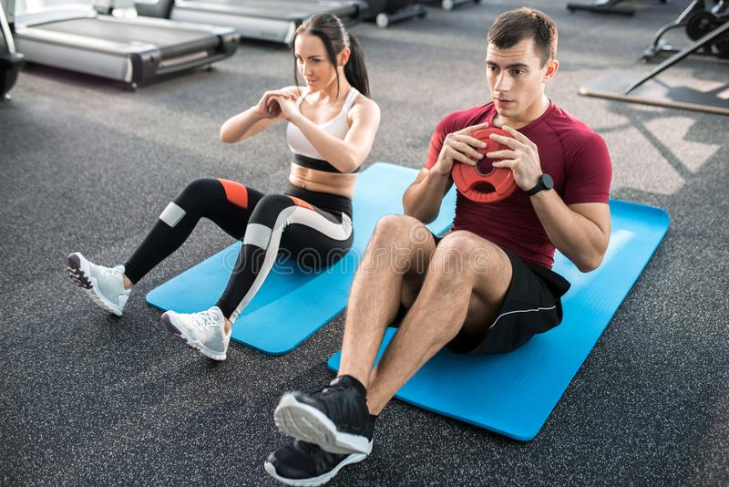Fitness People In Gym Doing Crunches Stock Photo Image