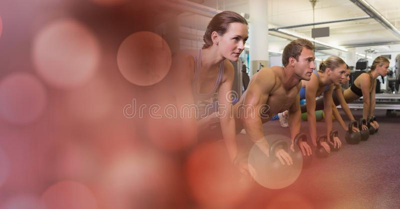 People doing push ups and red bokeh transition stock photos