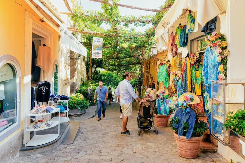 People doing shopping at street stores and market in Positano royalty free stock photo