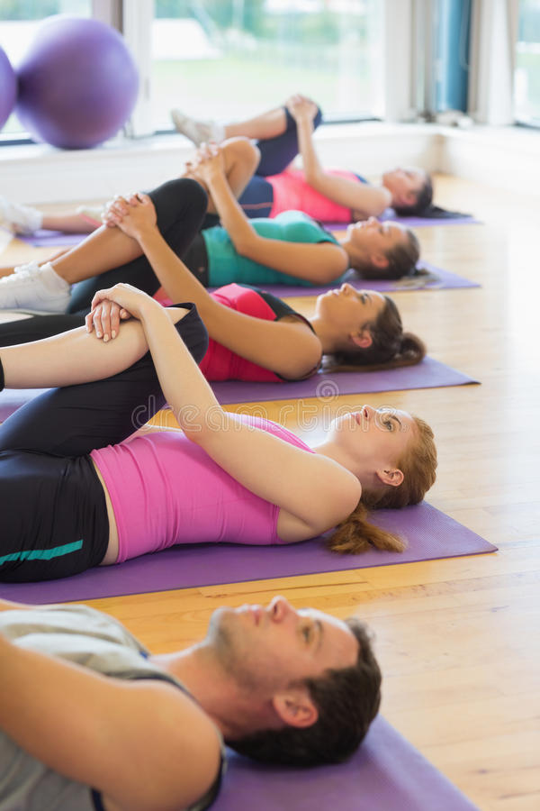 People Doing The Supine Wind Release Posture Stock Images