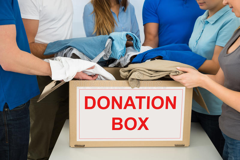 People donating clothes stock photo. Image of hand ...