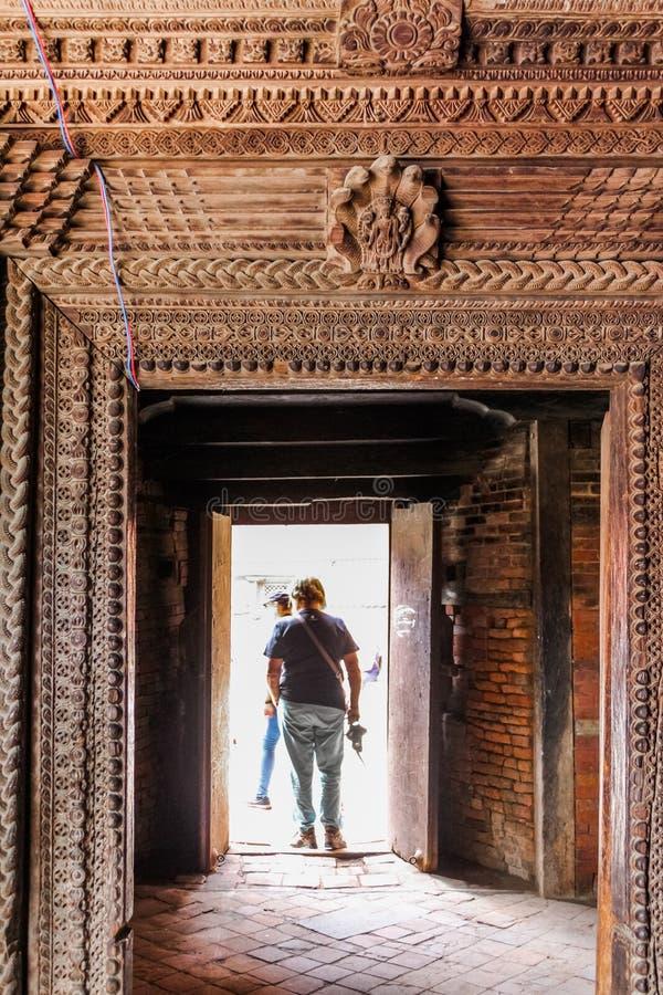 People at the doorway of Kumari Palace, Nine Storey Palace, Kathmandu, Nepal stock image