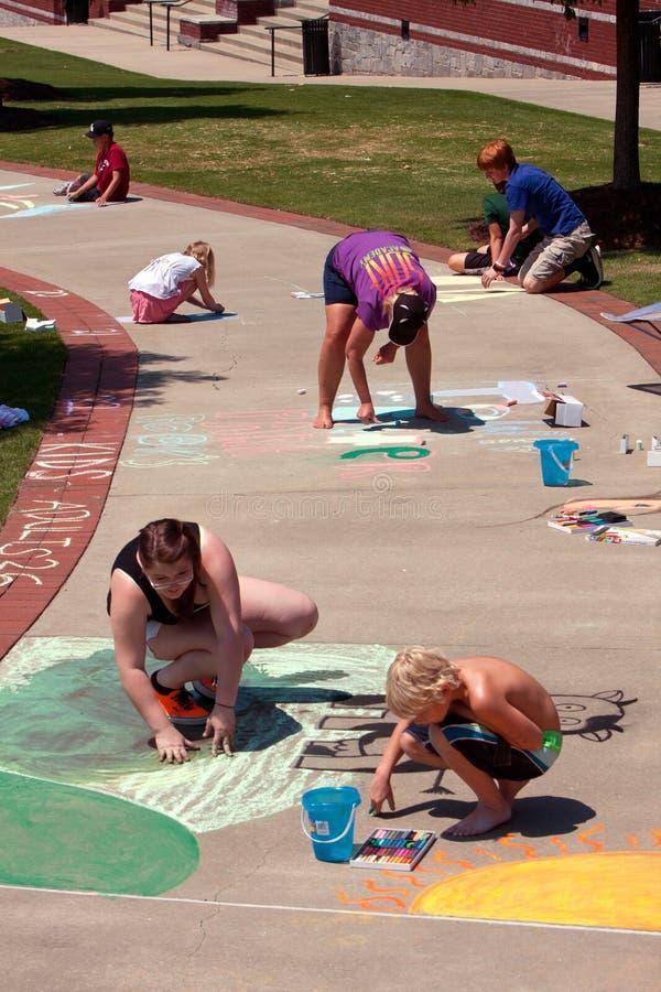 People Draw Sidewalk Chalk Art At Festival royalty free stock photography
