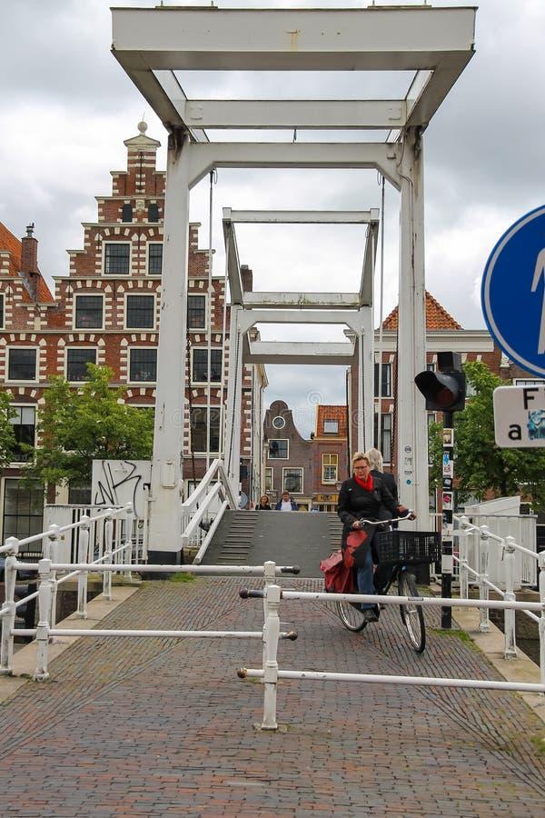 People on the drawbridge over Spaarne river in Haarlem stock images