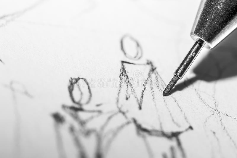 People Drawing. Closeup Photo Of An Architect Drawing Some People With A 0.5mm Pencil royalty free stock photography