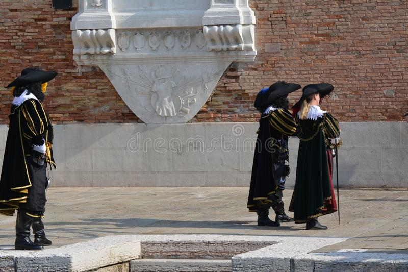 People dressed as eighteenth century Spanish soldiers at the Venice carnival. Three people dressed as Spanish soldiers of the eighteenth century at the Venice royalty free stock image