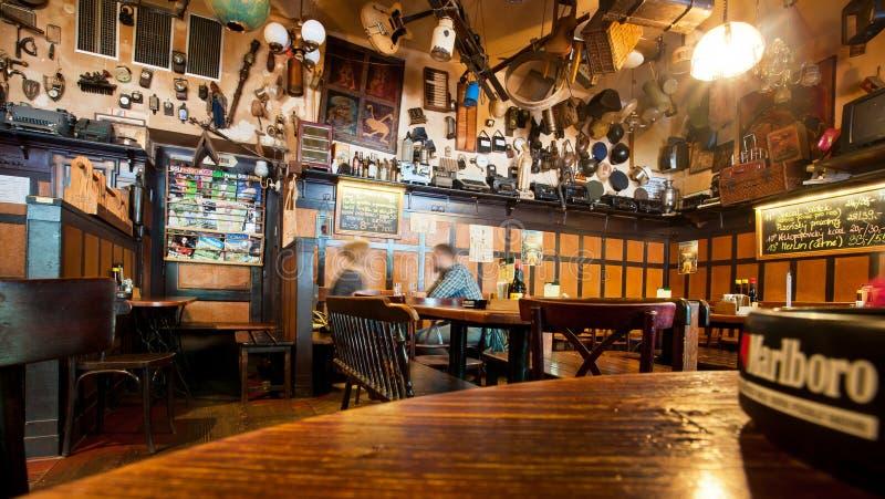 People drink beer inside the restaurant stock image