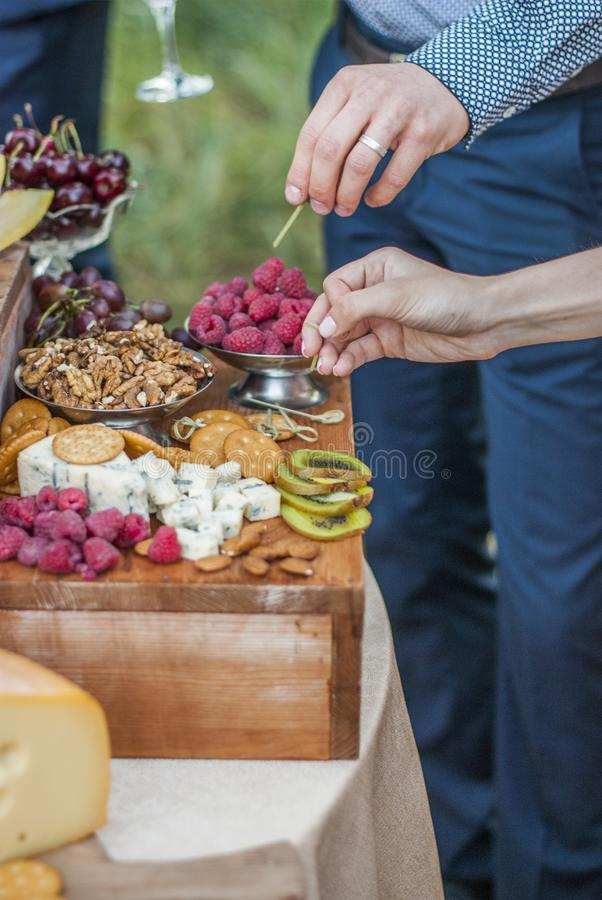 People drink champagne in the open air. People drink champagne. Open air party. Wedding reception with a buffet table stock images