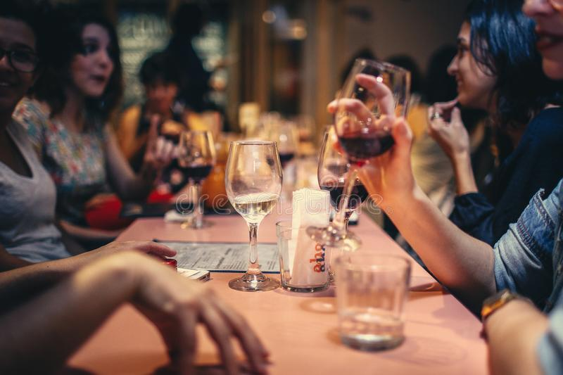 People Drinking Liquor and Talking on Dining Table Close-up Photo royalty free stock photography