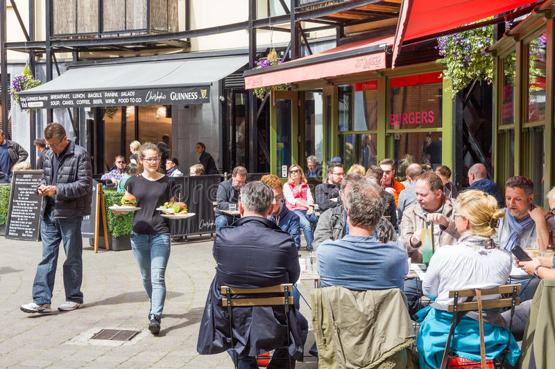 People drinking in a restaurant by the Guinness Storehouse, Dublin stock image