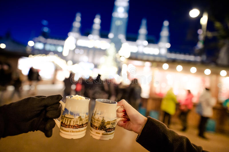 People drinking traditional Punch in Vienna Christmas Market, De. Cember 2016 royalty free stock image
