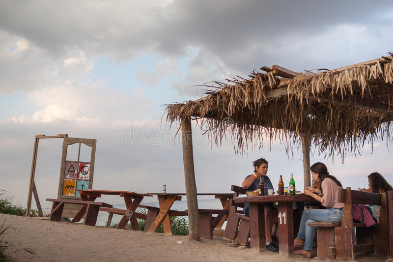 People eating on a beach restaurant stock photography