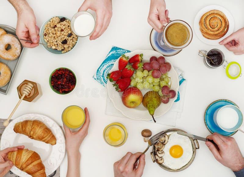 People eating breakfast royalty free stock images
