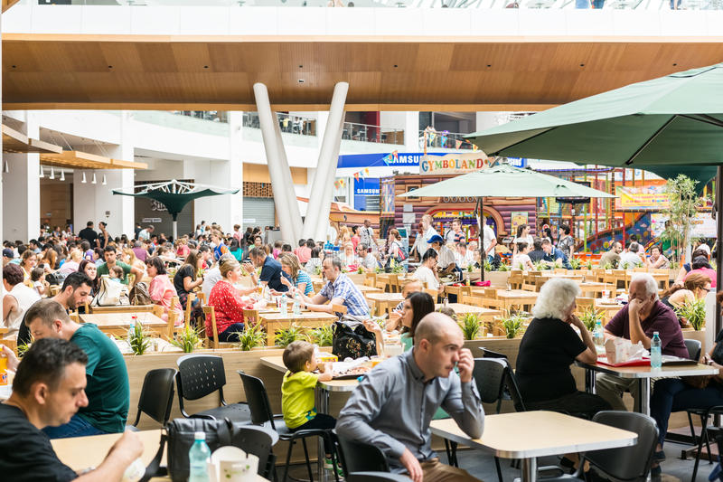 People Eating At Cafe Restaurant. BUCHAREST, ROMANIA - JULY 24, 2014: People Eating At Cafe Restaurant In Luxury Shopping Mall Interior stock photos