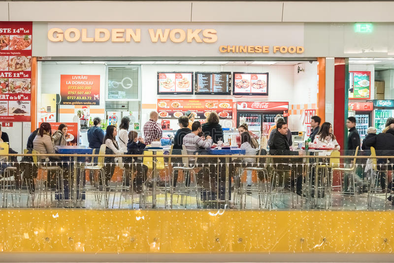People Eating Chinese Food. BUCHAREST, ROMANIA - JANUARY 02, 2015: People eating chinese food in shopping mall restaurant royalty free stock images