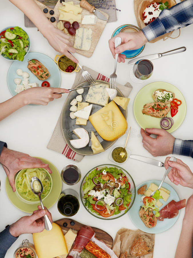 People eating dinner stock images