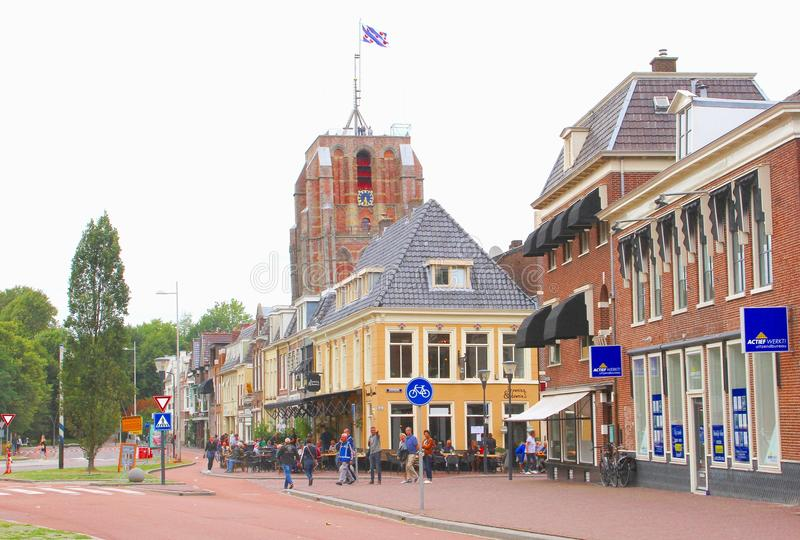 People cafe terrace historic buildings, Leeuwarden, Friesland, Netherlands royalty free stock photo