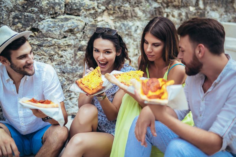 People eating fast food in city while travelling. Happy people eating fast food in city while travelling royalty free stock photo