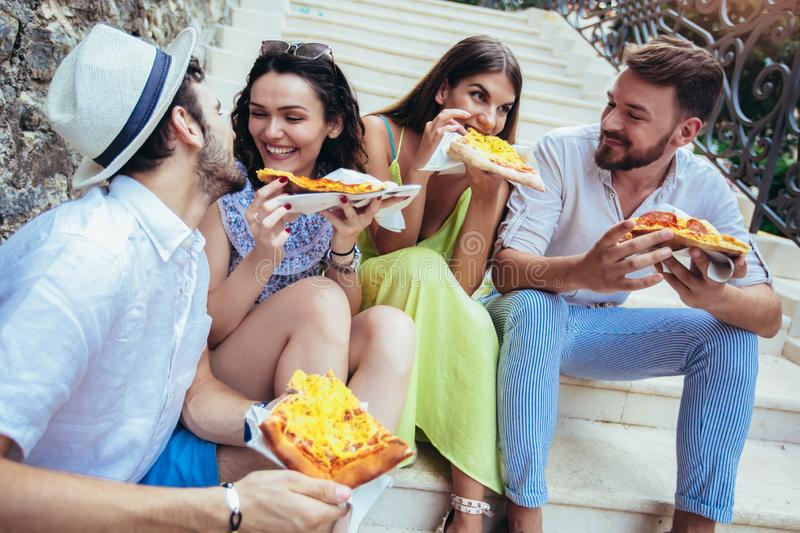 People eating fast food in city while travelling. Happy people eating fast food in city while travelling royalty free stock photos