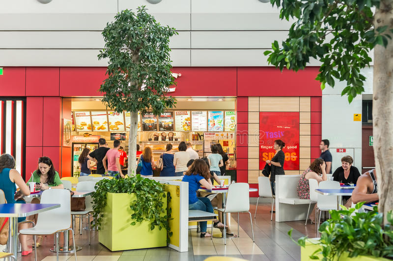People Eating At Fast Food Restaurants. BUCHAREST, ROMANIA - JULY 07: People Eating At Fast Food Restaurants In Luxurious Shopping Mall on July 07, 2014 In stock photography