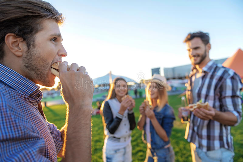 People eating and having fun outdoors stock photo