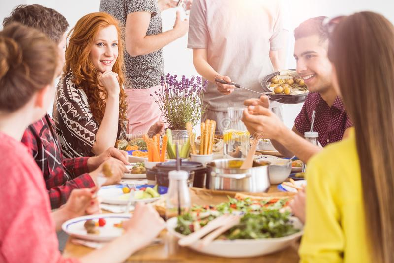 People eating healthy organic dishes royalty free stock photos