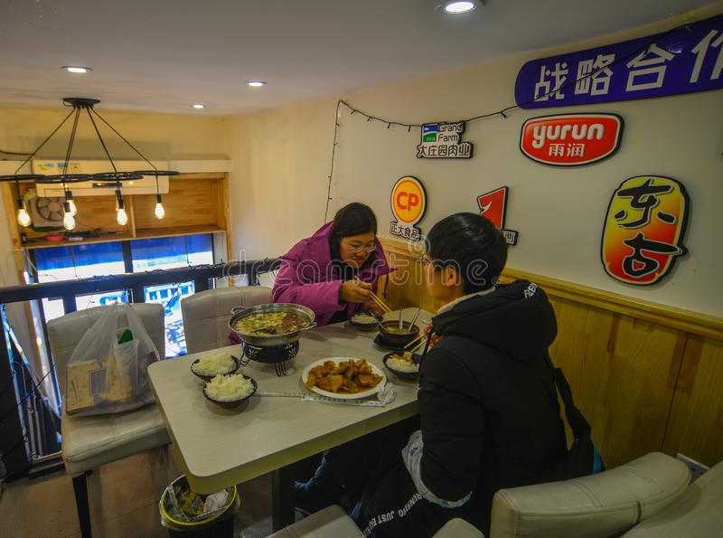 People eating at local restaurant stock image