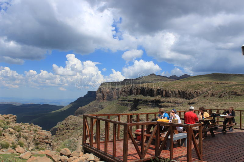People eating outside the sani mountain lodge in sani pass, Lesotho. Sani mountain lodge in Lesotho. The highest located bar in Africa. Popular for day tours royalty free stock image