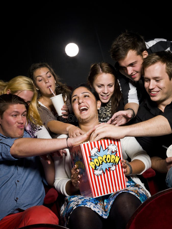 Download People eating popcorn stock photo. Image of laughing - 21373970