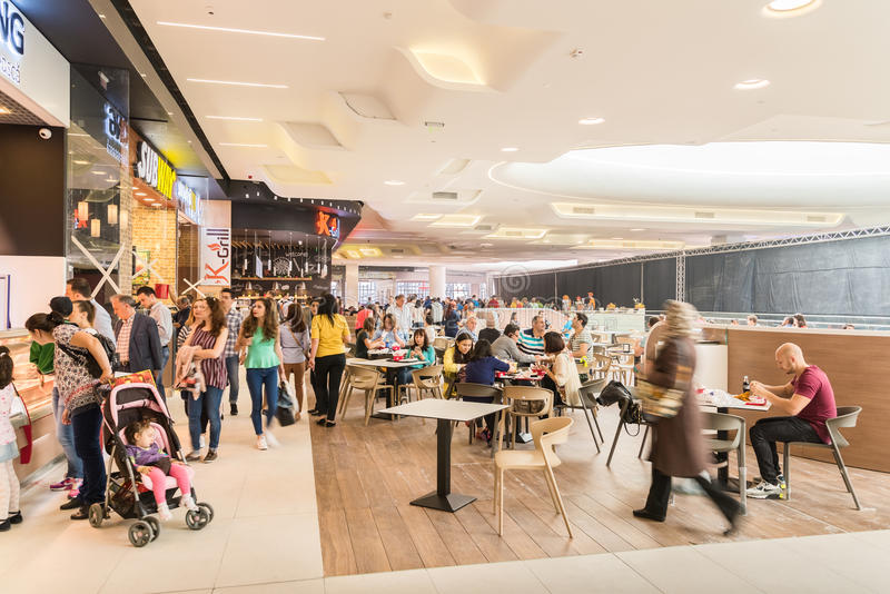 People Eating At Restaurant In Luxury Shopping Mall Interior. BUCHAREST, ROMANIA - MAY 15, 2015: People Eating At Restaurant In Luxury Shopping Mall Interior stock image
