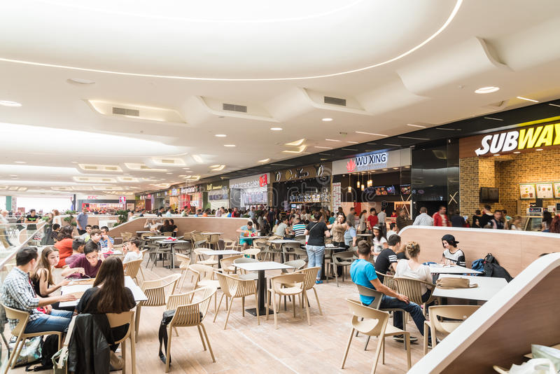 People Eating At Restaurant In Luxury Shopping Mall Interior. BUCHAREST, ROMANIA - MAY 15, 2015: People Eating At Restaurant In Luxury Shopping Mall Interior stock photography