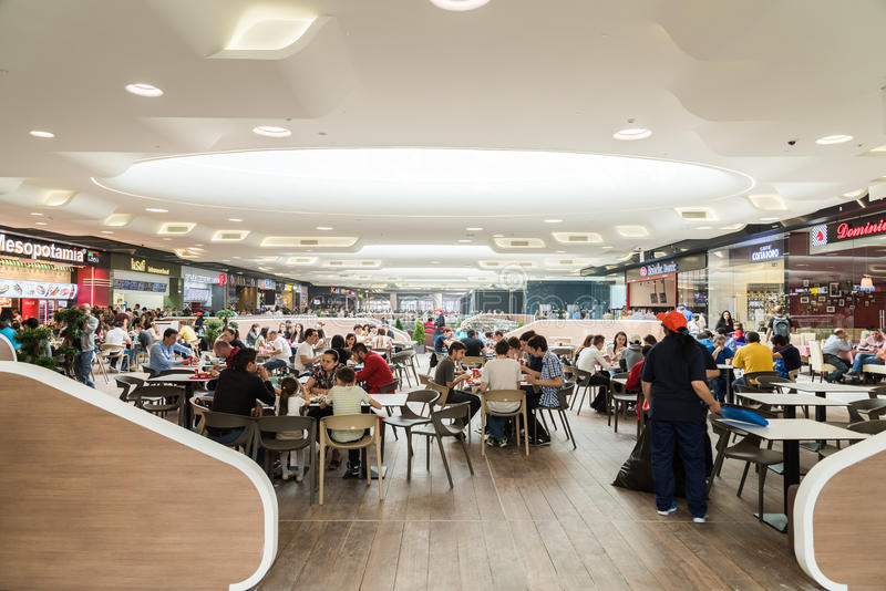 People Eating At Restaurant In Luxury Shopping Mall Interior. BUCHAREST, ROMANIA - MAY 17, 2015: People Eating At Restaurant In Luxury Shopping Mall Interior royalty free stock photos