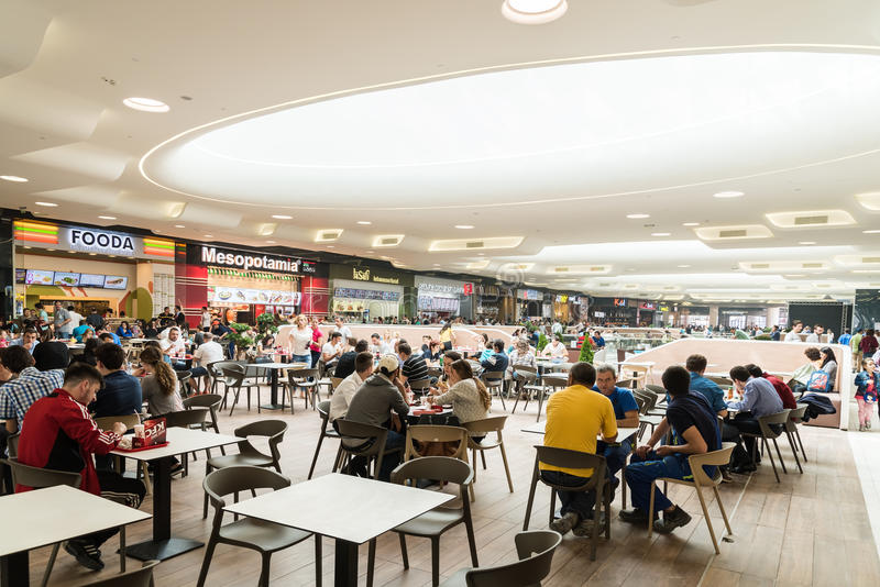 People eating at restaurant in luxury shopping mall