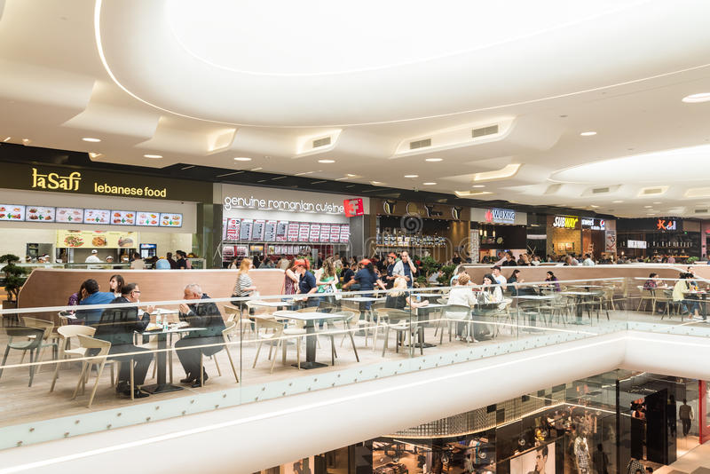 People Eating At Restaurant In Luxury Shopping Mall Interior. BUCHAREST, ROMANIA - MAY 17, 2015: People Eating At Restaurant In Luxury Shopping Mall Interior stock image