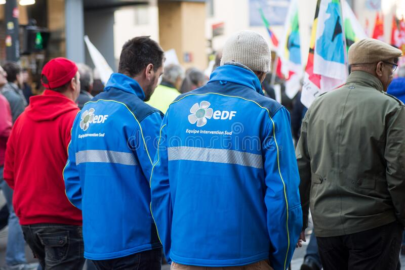 People with EDF jacket protesting against the pension reforms from the government in the street royalty free stock images